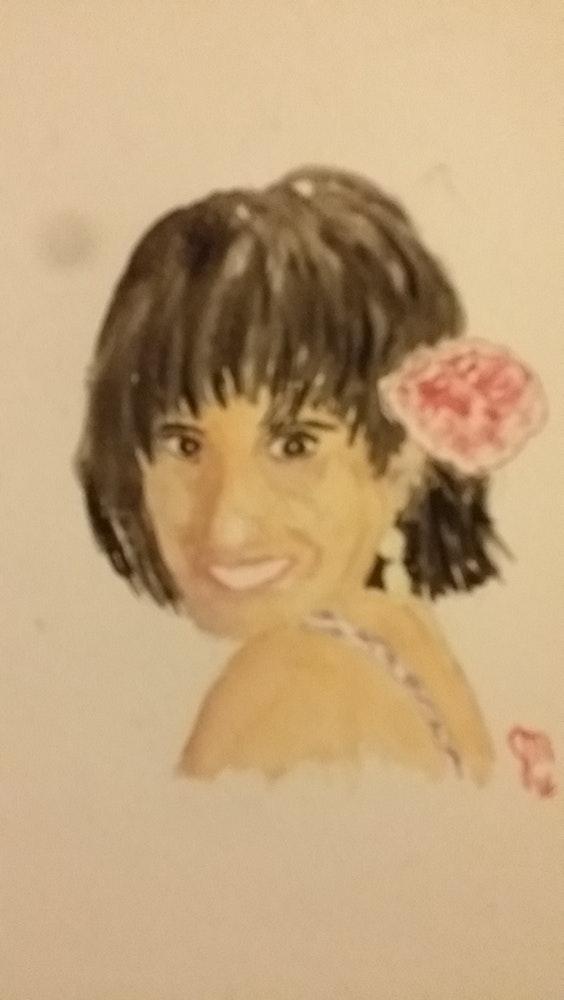 Lourdes with flower in her hair